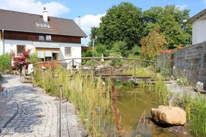 Einfamilienhaus mit großem Garten und Schwimmteich, nach Feng Shui geplant