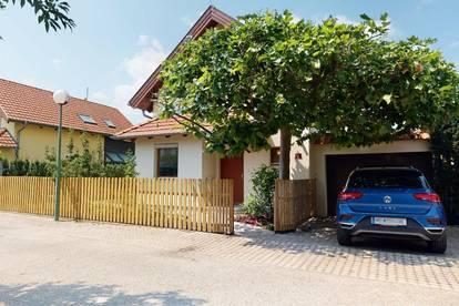 """""""We´re familiy!"""" im Wiener Becken: Gepflegtes 4-Zimmer-Haus mit idyllischem Feng Shui Garten samt Garage & Wintergarten zu kaufen!"""