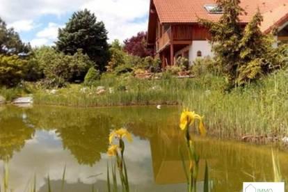 A Gumpoldskirchen - Top Ein bzw. Mehrfamilienhaus in mit großem Garten , 2 Garagen , Schwimmteich , Wintergarten und unverbautem Fernblick!