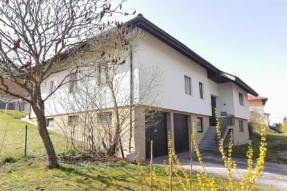 Attraktives Mehrfamilienhaus mit Garten und Doppelgarage