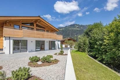 hochwertige Neubauwohnung mit großem Garten
