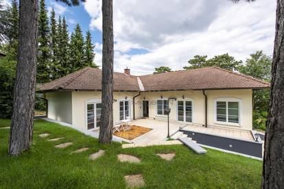 Moderner Bungalow mit wunderschönem Garten - in sehr guter Wohnlage