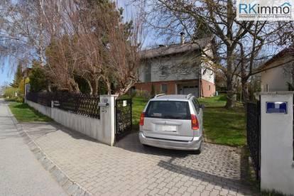 Mehrfamilienhaus, vollunterkellert mit Garage und großen Garten RUHELAGE !
