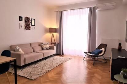 STEPHANSPLATZ-NÄHE; klimatisierte 84 m2 Altbau inkl. 5 m2 Loggia, teilmöblierte 3 Zimmer, WG-geeignet, Komplettküche, Parketten;