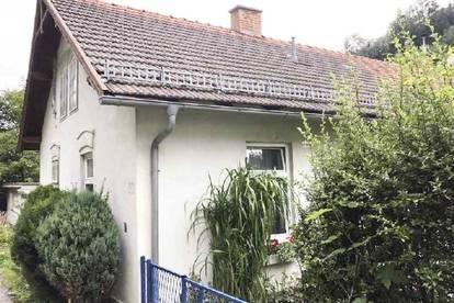 Wohnung mit Garten und Carport zu verkaufen