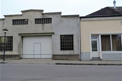 Geschäftslokal mit kleiner Wohnung und großer Halle nahe Bahnhof