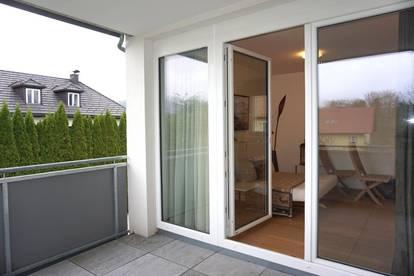 NEU IM ANGEBOT - Hochwertige 2 - Zimmer Wohnung - möbliert, mit großem Balkon, Tiefgarage und Lift in Mondsee - ODILOS-GARTEN