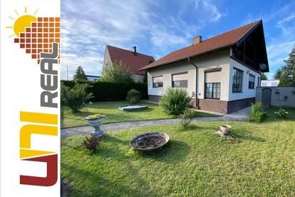 - UNI-Real - Einfamilienhaus mit Garten in traumhafter Lage!
