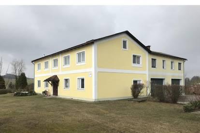 Haushälfte mit 3 vermieteten Eigentumswohnungen zu verkaufen