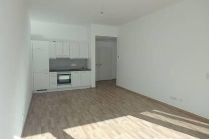 Neue 2-Zimmer Wohnung mit Loggia, eigenem Gartenanteil, Lift und Garagenplatz