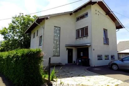 Einfamilienhaus mit Garage und Nebengebäude!