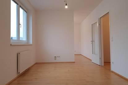 Neubau mit Tiefgarage & Balkon, ruhig gelegen!