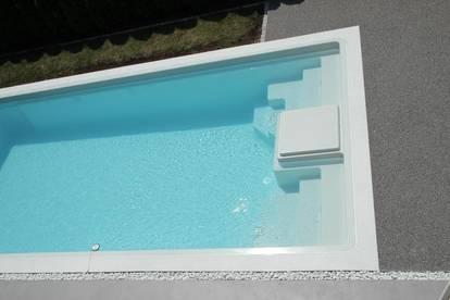 MANNLICHER   Top ausgestattetes Einfamilienhaus mit Pool und Carport