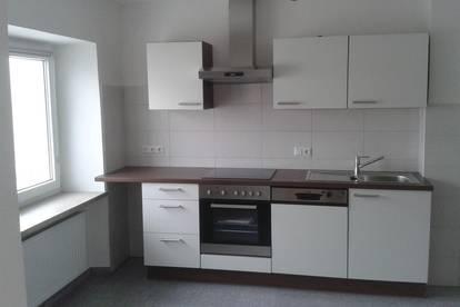 Geräumige, neuwertige 2-Zimmer-Wohnung mit möblierter Küche in Aspach