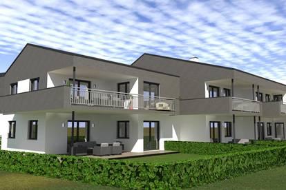 Moderne Neubauwohnung mit großer Terrasse und Grünfläche