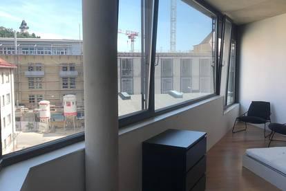 Moderner Designwohnung mit Ausblick auf den Uhrturm