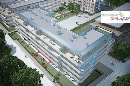 Top Wohnung im Erdgeschoss mit großer Terrasse, Garten, Tiefgarage und Kellerabteil