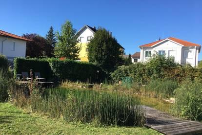 Top Wohnung mit Garten und Schwimmteich