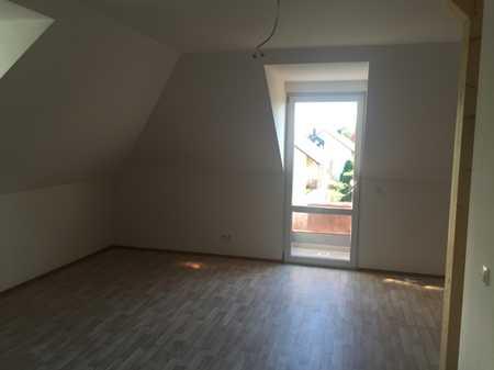 Gepflegte Dachgeschosswohnung mit zwei Zimmern und Balkon in Mühldorf am Inn in Mühldorf am Inn