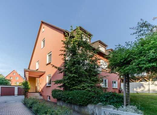 Zentrumsnahe Wohnung mit Gartenanteil in Dreifamilienhaus.