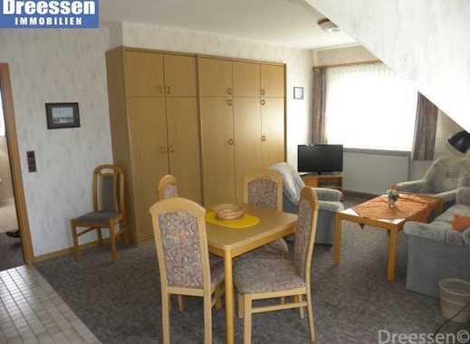 Büsum: Freundliche 2-Zimmer Mietwohnung mit Balkon, Kfz-Stellplatz und Waschkeller