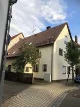 Haus mit Einliegerwohnung und Gewerbeeinheit