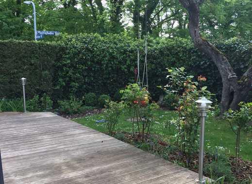 Schöne Souterrain Wohnung mit großem Garten und Holzterrasse in Schwabing Freimann zu vermieten