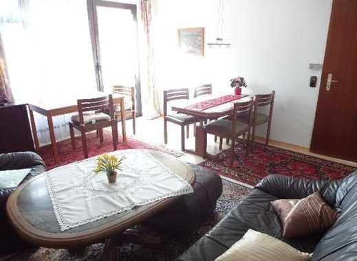 Gepflegte 2 Zi-EG-Wohnung mit Einbauküche, Terrasse & Kfz.-Platz! Wahlweise möblierte oder leer.