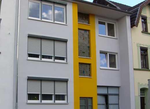 Mehrfamilienhaus mit Garten-Grundstück und vier Garagen in Duisburg-Aldenrade, kompl. vermietet