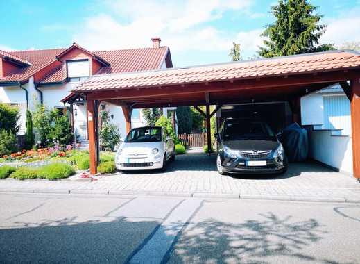 Exklusive Doppelhaushälfte mit Garten in familienfreundlicher Lage