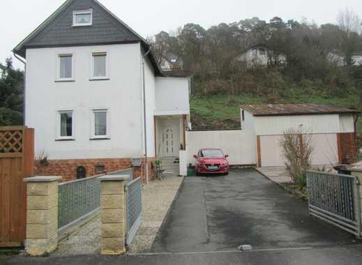 Gemütliches Einfamilienhaus mit großem Grundstück und Doppelgarage