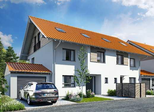 Charaktervolle Doppelhaushälfte mit viel Raum und positiver Energiebilanz im Münchner Süden