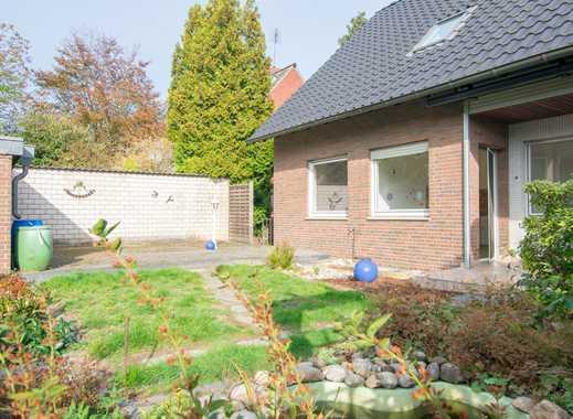 Freistehendes Einfamilienhaus auf sonnigem Grundstück mit Garage in beliebter und ruhiger Lage