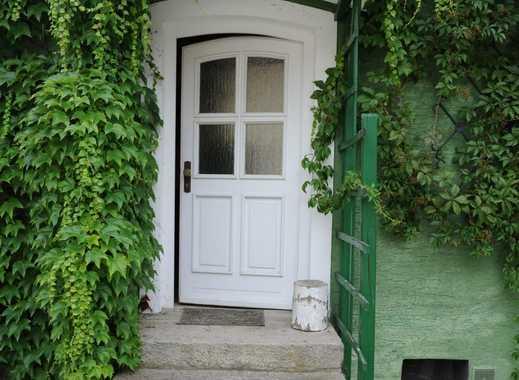 Grünes Haus, kleiner Garten, großes Glück