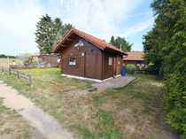 Kleines Holzhaus im Ferienpark in