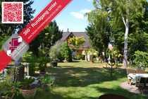 Bild Einfamilienhaus mit separater Einliegerwohnung der Extraklasse mit großem Gartengrundstück