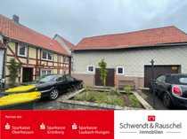 Einfamilienhaus mit Garage und Freisitz