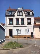 KAPTALANLAGE - 3-Parteien-Wohnhaus mit 9 Garagen in