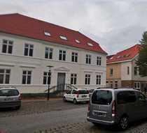 2 Mehrfamilienhäuser und einem Baugrundstück