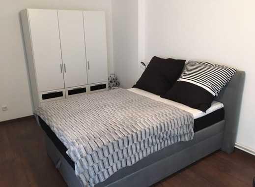 Komplett eingerichtetes Apartment mit einem Schlafzimmer und zwei Schlafzimmern