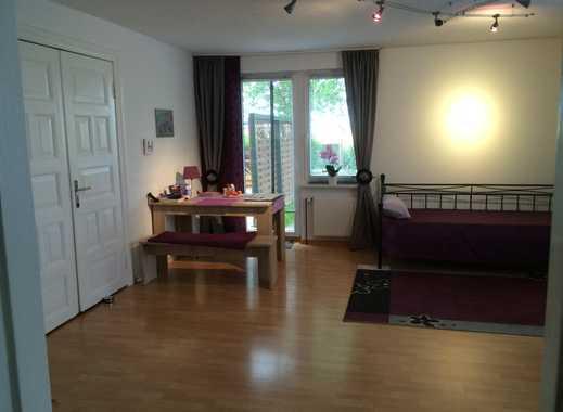 Gepflegte 2-Zimmer-EG-Wohnung mit Terrasse und Einbauküche in Friedrichskoog