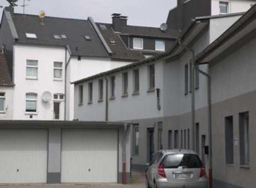 Kernsaniertes Wohn- und Geschäftshaus mit Büro- oder Praxisräumen, 14 Garagen + 3 Mietwohnungen