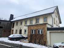 Einfamilienhaus mit Garage und Nebengebäude