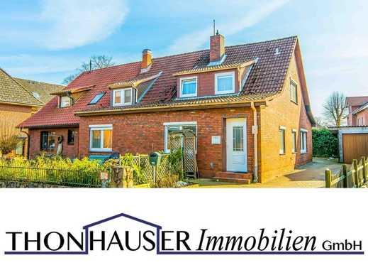 Doppelhaushälfte mit vermieteter Einliegerwohnung und Garage in 22946 Trittau