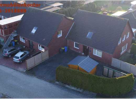 Kapitalanlage!! Doppelhaus mit 4 Wohnungen und 2 Garagen in Krummhörn Loquard