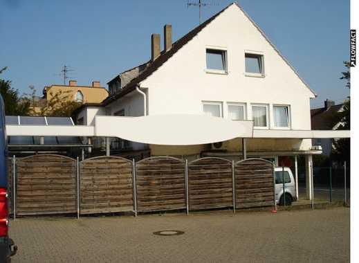 Attraktives, gepflegtes Anlageobjekt mit insgesamt 2 Wohnungen und einer Gewerbefläche