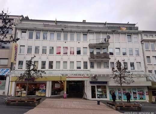 Zentral gelegenes Wohn- und Geschäftshaus mit Ladenpassage