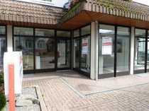 Erstklassige Ladenfläche mit großen Fensterfronten