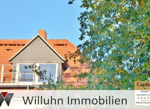 **Gemütliche Dachgeschosswohnung** mit offenem Küchenbereich