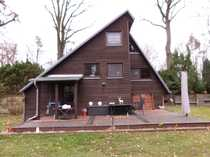 Bebautes Wassergrundstück mit einem Finnhaus